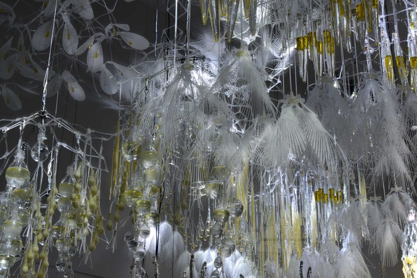 Philip Beesley: radiant soil at espace EDF in paris — THE OPSIS: Scent-emitting glands attract viewers and encourage interaction with the system, providing stimulus that increases air circulation and protocell formation.