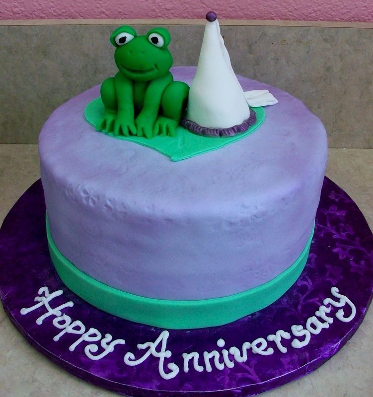 Fairytale anniversary cake with fondant frog and princess