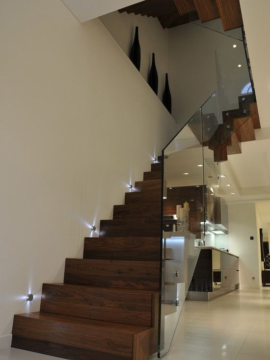 Cool lighting, gorgeous wood color, and love the glass railing