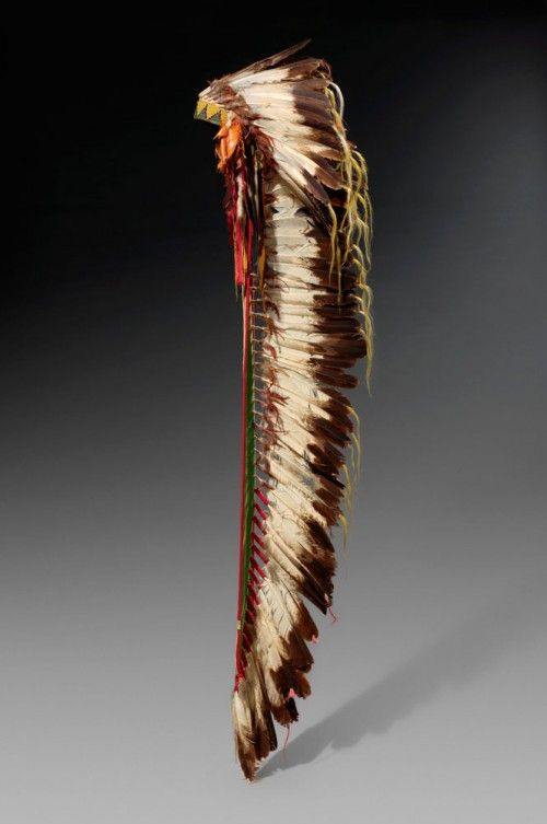 United states ~ Montana | Eagle feather war bonnet / headdress from the Northern Cheyenne people | Eagle, hawk, owl and raven feathers, rawhide, native leather, wool and cotton cloth, glass beads, ermine skin, silk ribbon and horsehair | ca. 1875