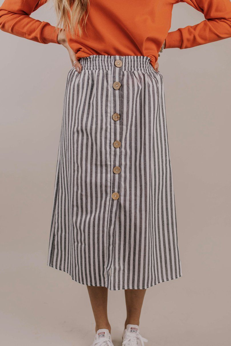 1ef7658d0 Stripe button skirt outfit ideas. Knee length midi skirt. Cute and casual  spring skirt. Church outfit ideas for spring. 2019 fashion trends. | ROOLEE