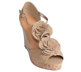 We hear that #nude color shoes elongate legs. Loving the floral detail and the cork wedge.
