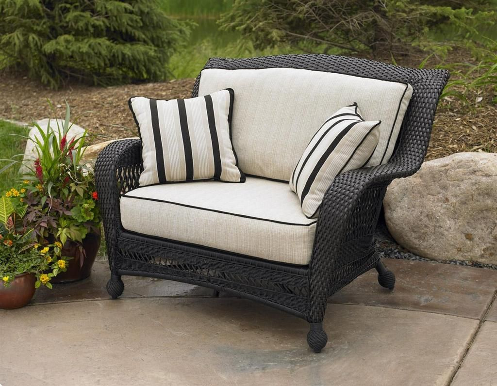 this ebony wicker patio chair is extra wide for extra comfort with