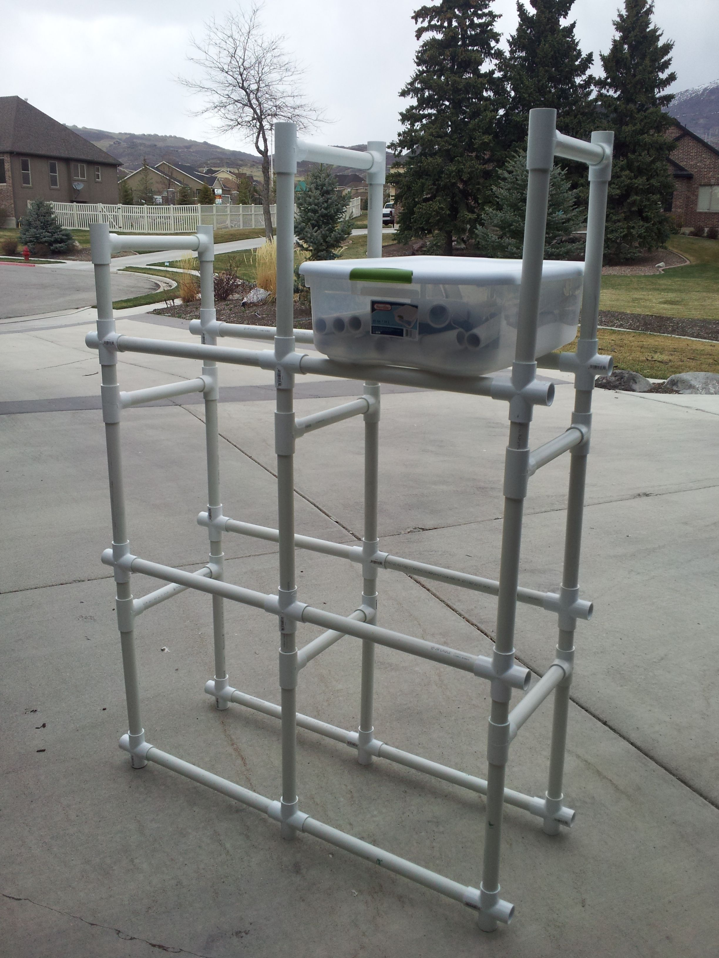 """Storage bins made of PVC. Simple and easy, anyone can do this project. Bins shown can hold up to 600 pounds. Materials used in this picture; PVC cutter or saw, 18- X's, 18- T's, 12- 1"""" pipe at 20 """", 9- 1"""" pipe at 12"""", 12- 1"""" pipe at 4"""". Can make this as tall and as wide as you want. For extra security when in use attach back side to wall with some sort of strap in 2 or more areas. No need to glue, easy to pack or unpack and assemble"""