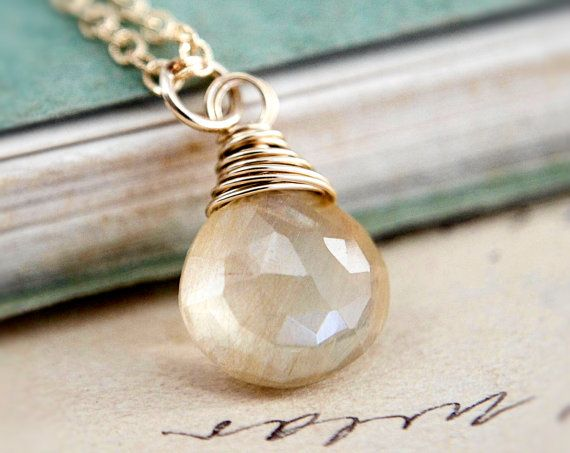 This necklace features a shining golden Rutilated Quartz faceted briolette, wire…