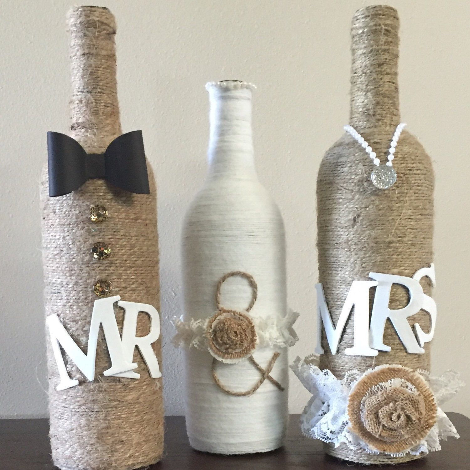 Wedding decorations with wine bottles  Mr and mrs A perfect center piece  Rehearsal dinner center pieces