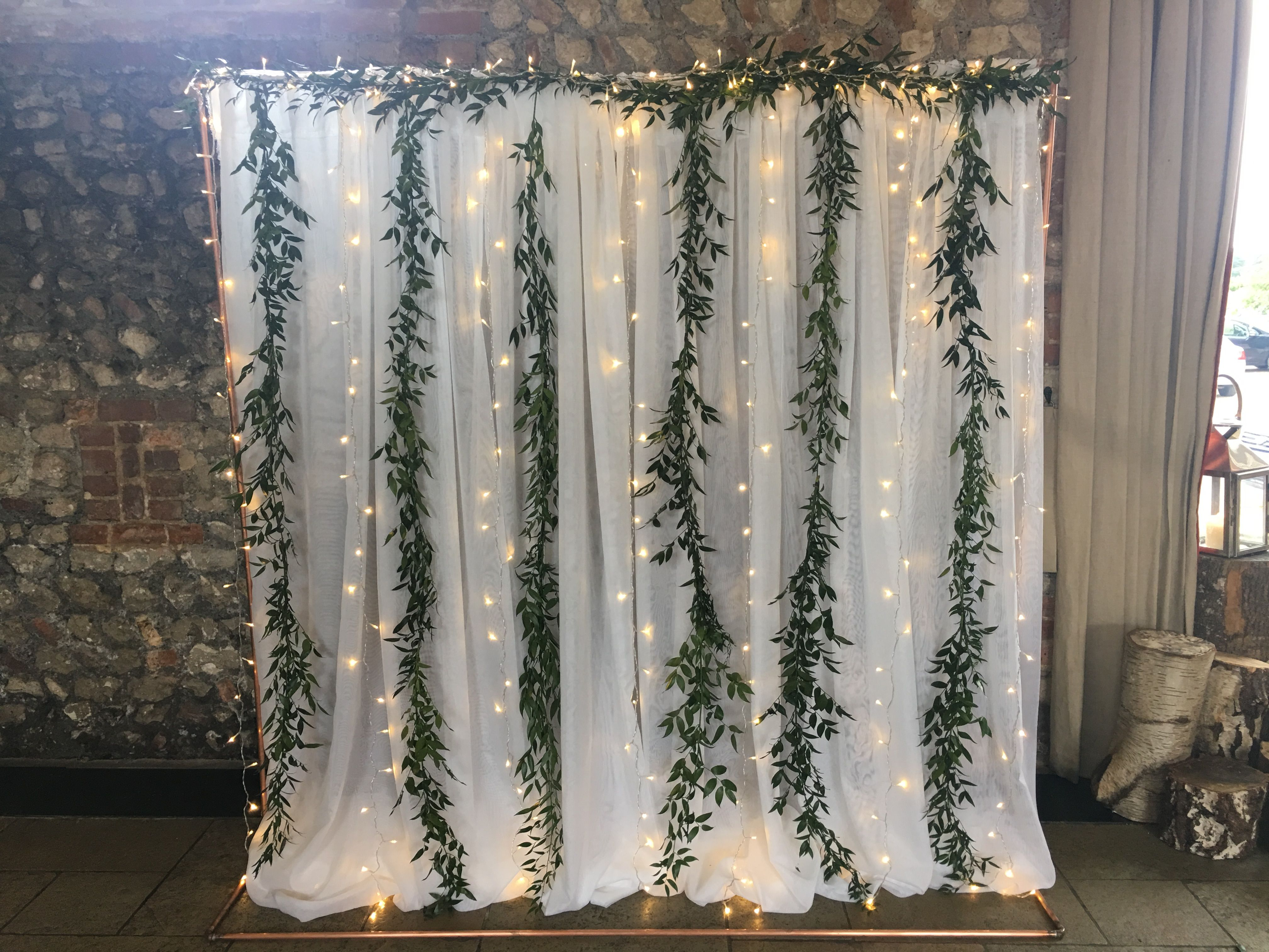 Wedding decorations stage backdrops october 2018 Copper pipe framed backdrop with cascading fairylights voile