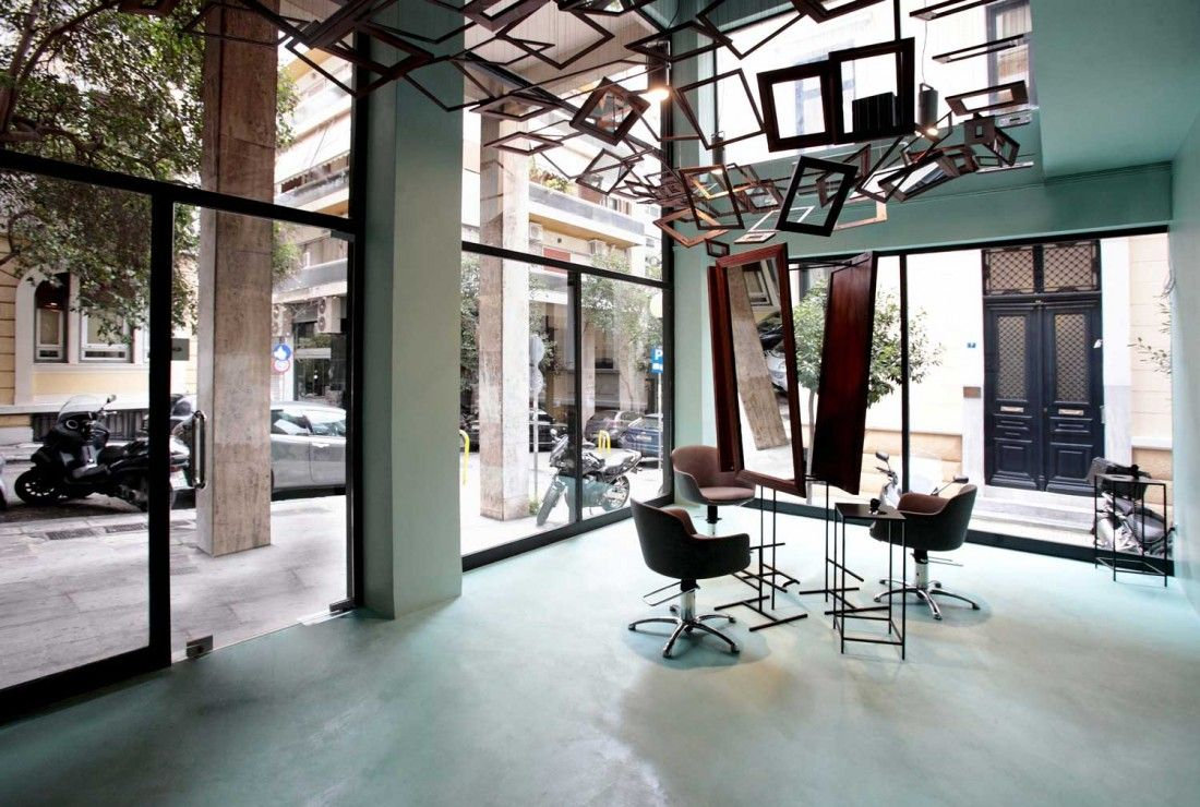 Athens hair salon features a suspended canopy of mirrors & frames - Retailand Retail Design