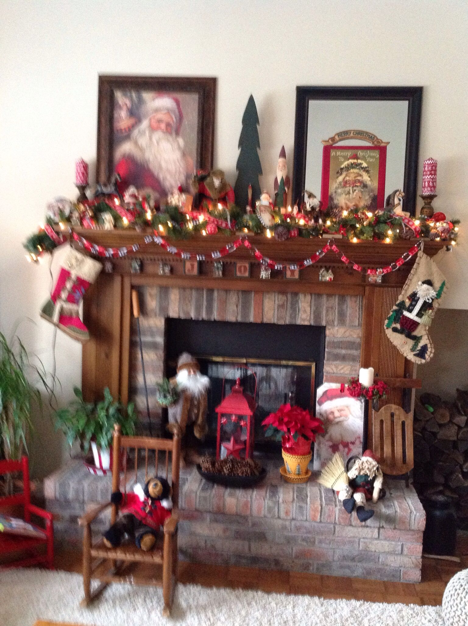 Santa Portrait Anchors The Mantle And Antique Santas Are Added