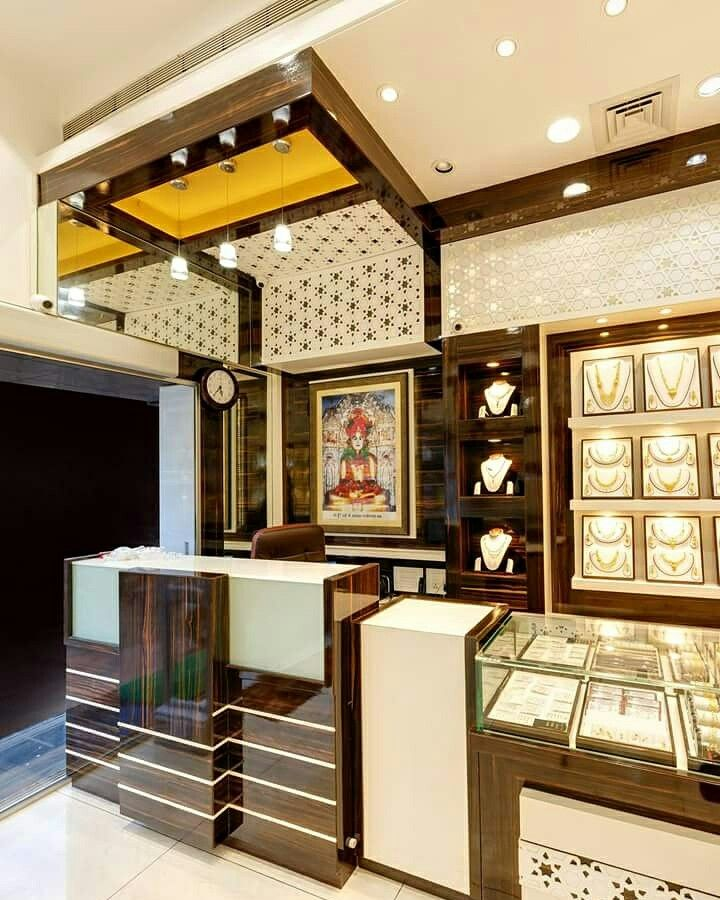Backside counter jewelry store displays design jewellery display showroom also luxury cnc false ceiling with led caredecor rh pinterest