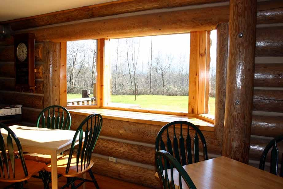 Bay window homes wallace falls log home builders for Log cabin window