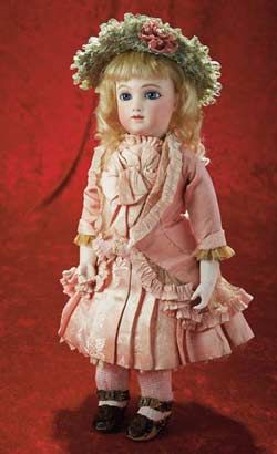 """This Thuillier doll is close in description to a doll Clark purchased at a May 18, 1993, Sotheby's auction. It was one of two antique dolls she purchased that day. Clark's Thuillier was described in the auction catalog as a pressed bisque doll, circa 1885, with pierced ears and a blond mohair wig. She was dressed in a pink silk dress with cream overdress and a straw bonnet. The doll bore maker's mark """"A6T"""". Clark's winning bid was $14, 054. She authorized her attorney to bid up to $90,000."""