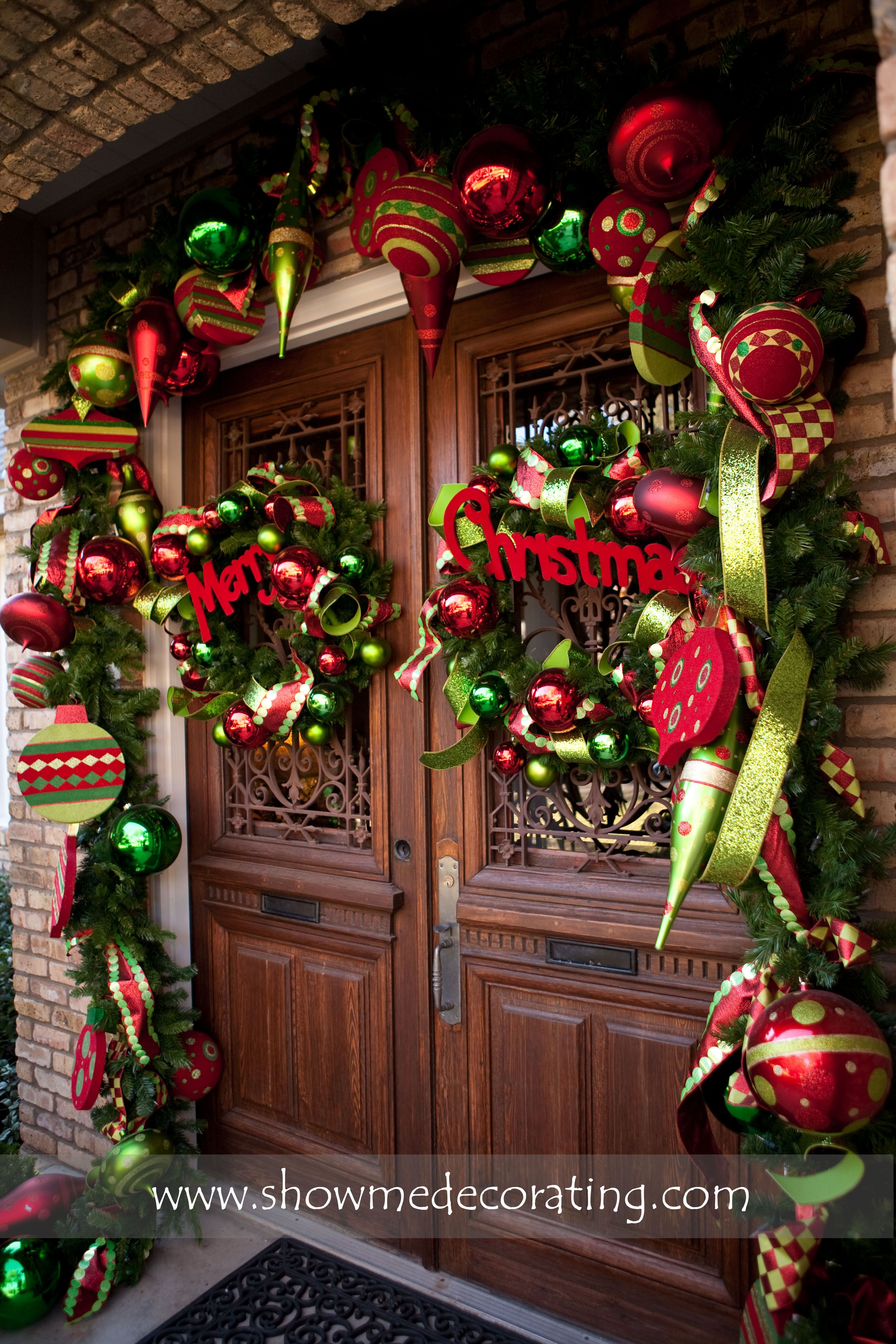Christmas Garland And Matching Wreaths Make This Doorway