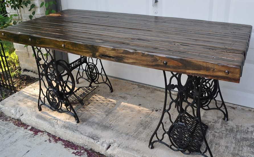 two old singer sewing machine bases for the top 2x4s put together disressed and stained to. Black Bedroom Furniture Sets. Home Design Ideas