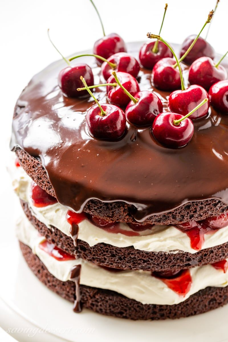Enjoy our best Black Forest Cake recipe for your next special occasion! This towering 'naked' version of the iconic German dessert does not disappoint. #blackforest #blackforestcake #baking #cake #chocolatecake #cherrycake #blackforestcakerecipe #blackforestgateau #specialoccasioncake