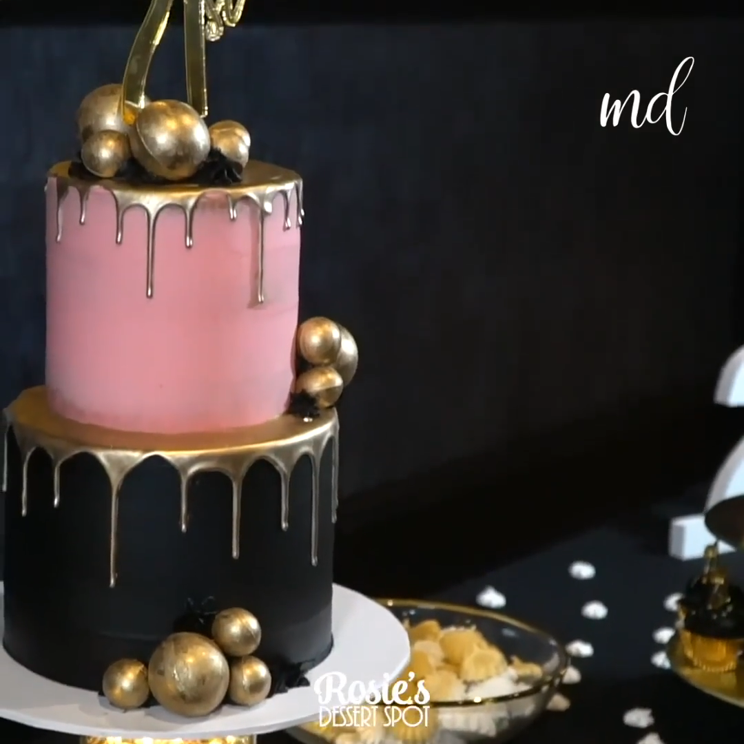 Photo of Black and Gold Drip Cake Art