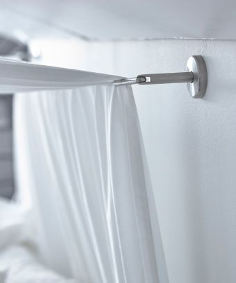 A Close Up Image Of A Curtain Wire Used To Hang A Canopy Over A