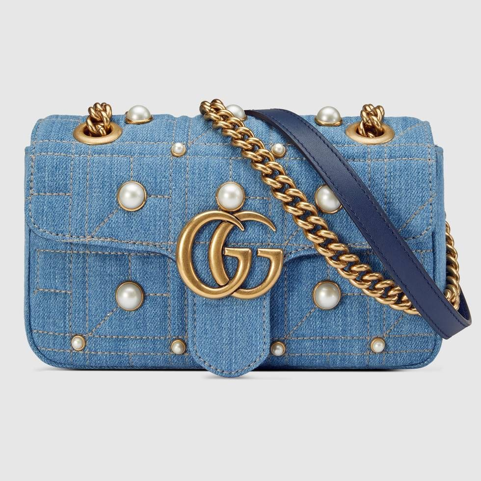 2128b83fbade Shop the GG Marmont denim mini bag by Gucci. The mini GG Marmont chain  shoulder bag has a softly structured shape and an oversized flap closure  with Double ...