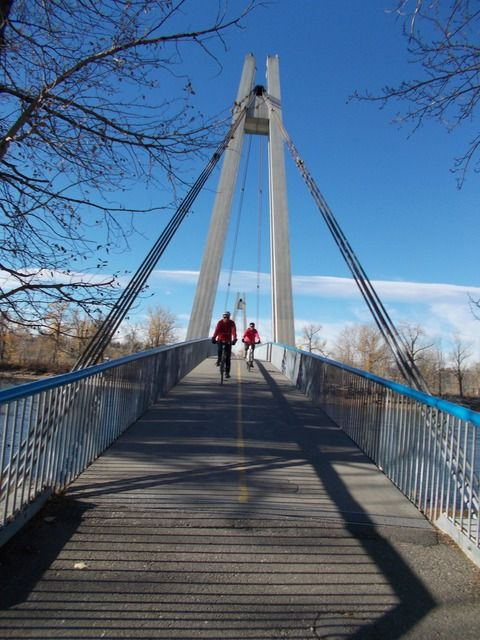 My friends Dave and Carole cycling on Southland Bridge Calgary Oct. 22. '14