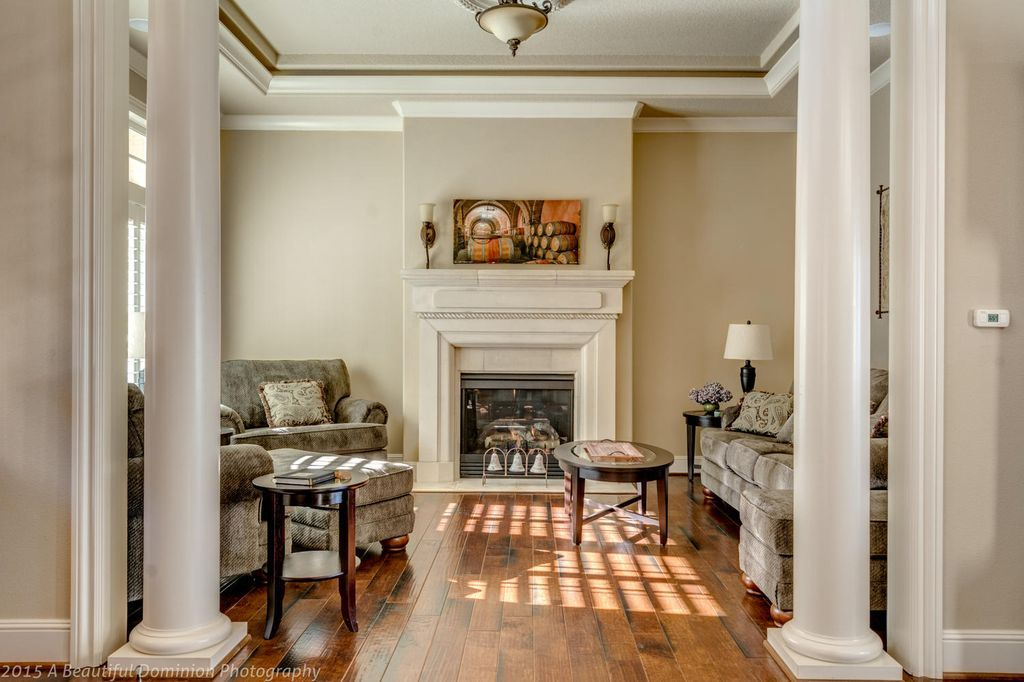 Traditional Living Room With Columns Flush Light Crown