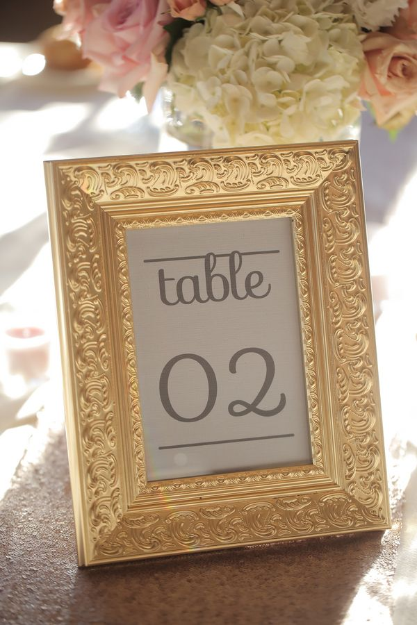 Cute DIY gold frames for table numbers. View the full wedding here ...