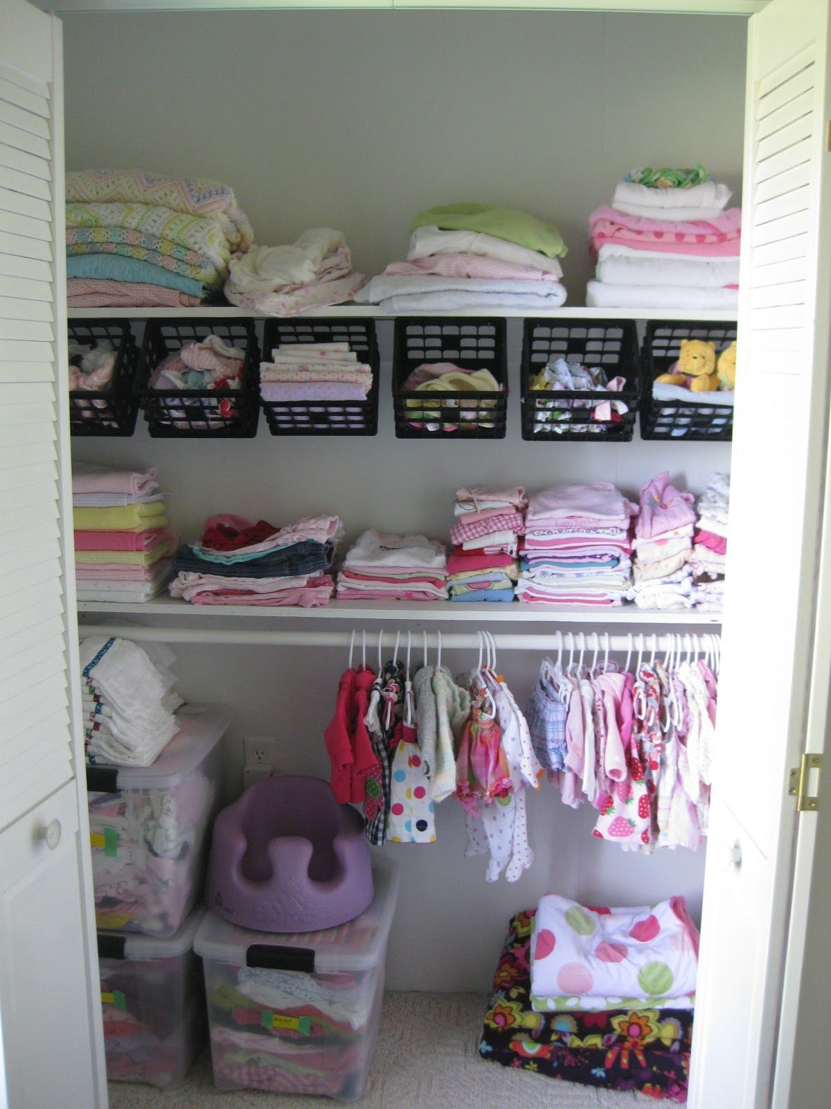 Dollar Tree Crates Hung Under A Shelf! Genius!   Baby Closet, Nursery Closet Organization, Baby Closet Organization