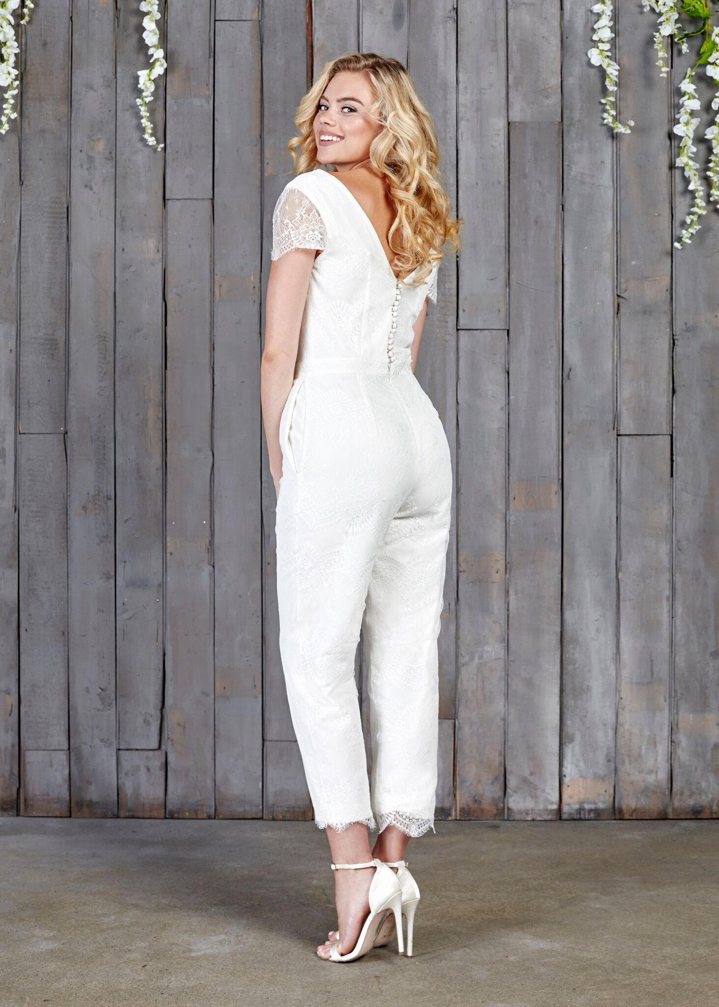c85637e703 This beautiful House of Ollichon bridal jumpsuit is made entirely of lace  which comes all the way from Australia and boasts a contemporary