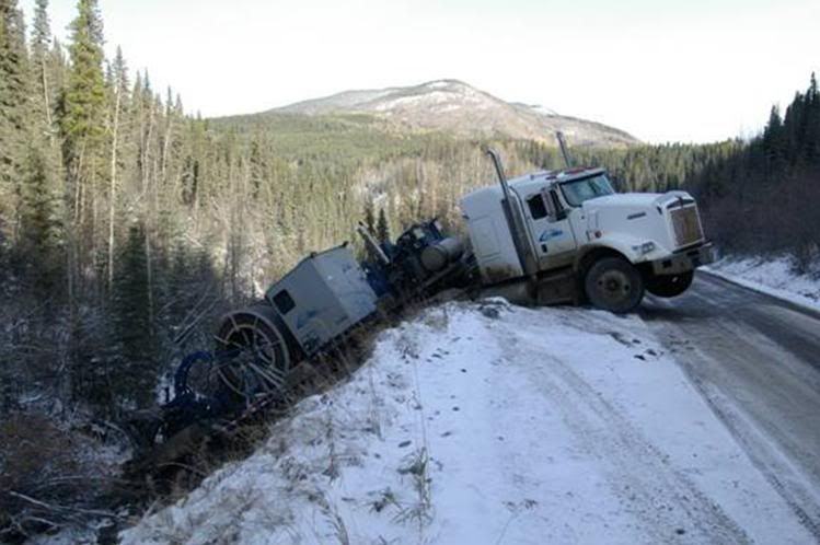 Image result for tow trucks pulling semi out of ditch
