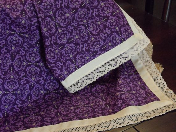 Beautiful plum (purple) colored handmade baby girl blanket with plum (purple) and ivory pattern with ivory grosgrain ribbon trim and ivory crochet.