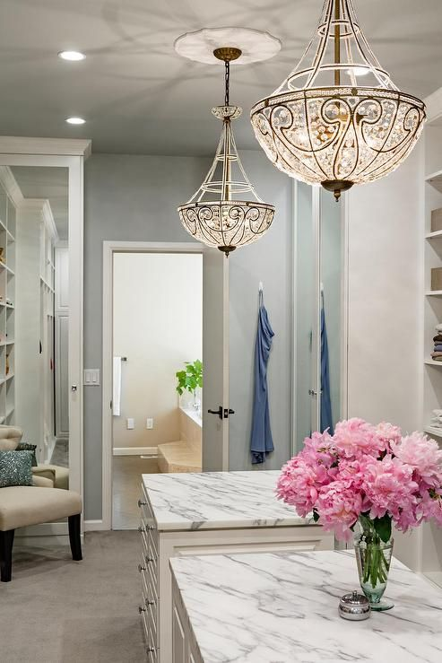 Sophisticated walk in closet features a pair of matching beaded sophisticated walk in closet features a pair of matching beaded chandeliers hanging over side by aloadofball Gallery