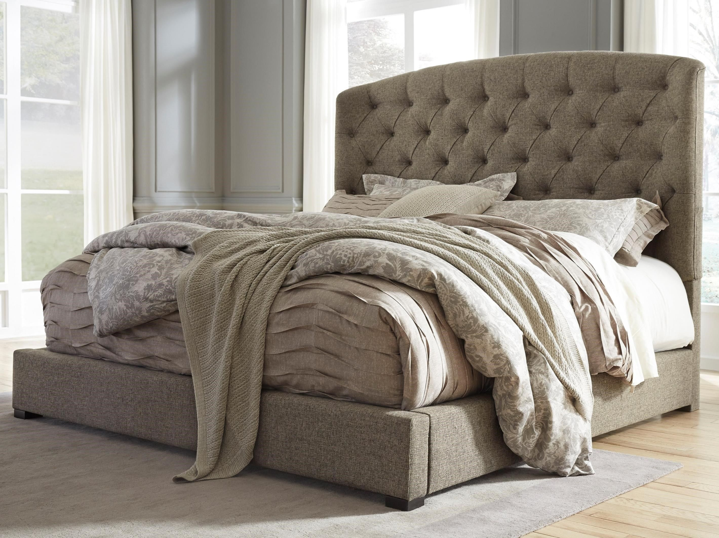 A Tall Diamond Tufted Arched Upholstered Headboard With