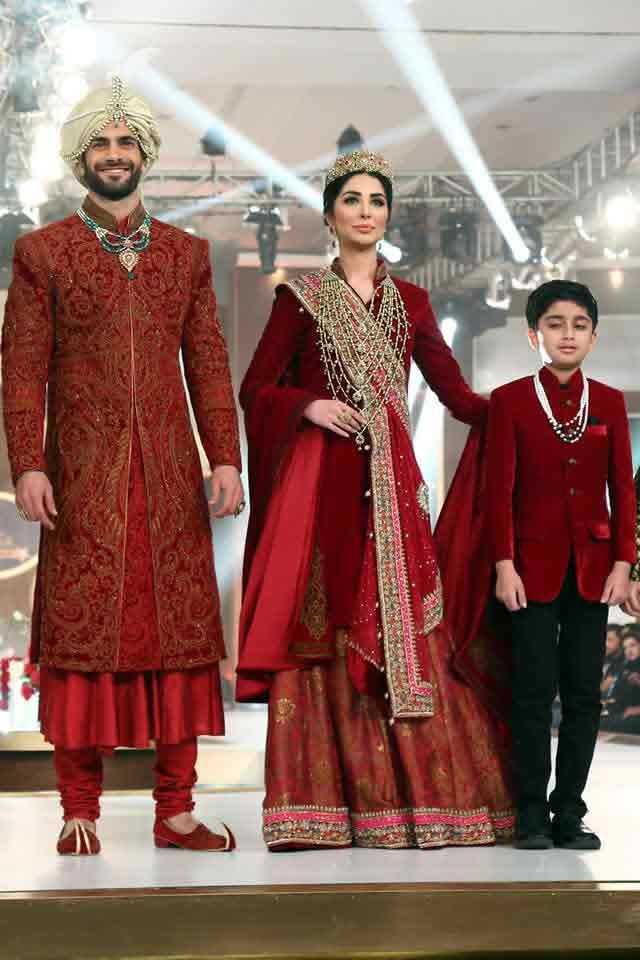 6562126abe Bridal in traditional maroon long shirt with sharara and groom in matching  sherwani with pajama trouser latest indian and pakistani wedding matching  dress ...