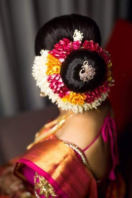 South Indian Bridal Donut Bun With Pin Indian Bridal Hairstyles South Indian Wedding Hairstyles Trendy Wedding Hairstyles