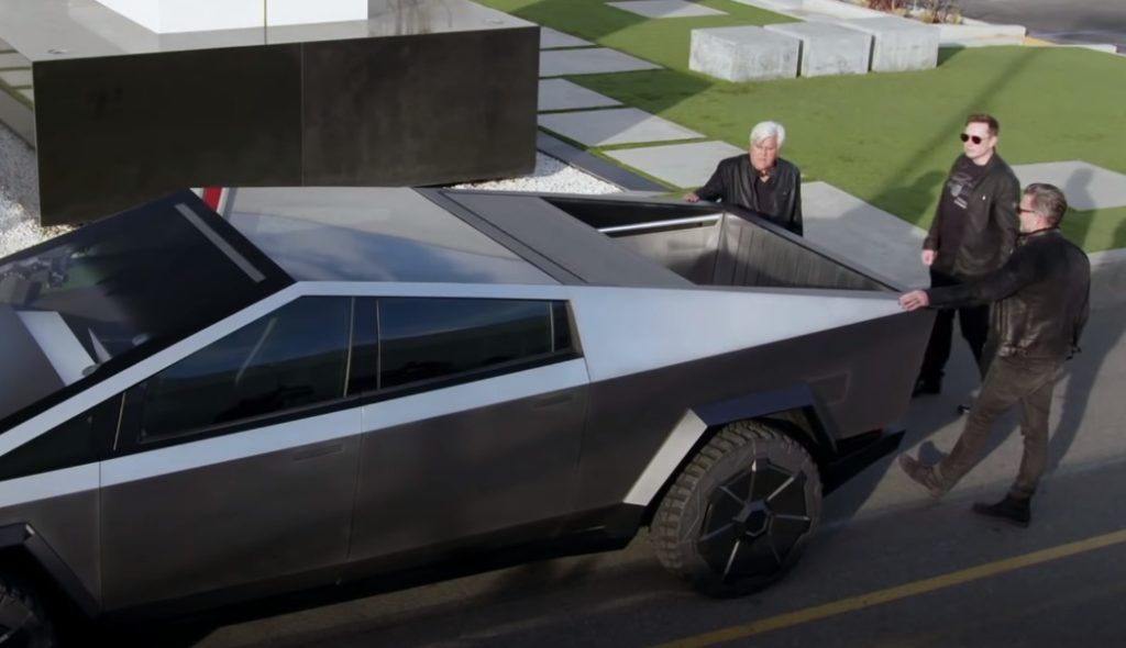 Get An Up Close Look At The 2021 Tesla Cybertruck With Elon Musk And Jay Leno Elon Musk Tesla New Pickup Trucks