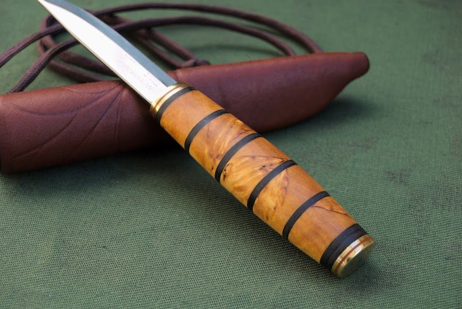 Handmade puukko knife with curly birch and leather handle