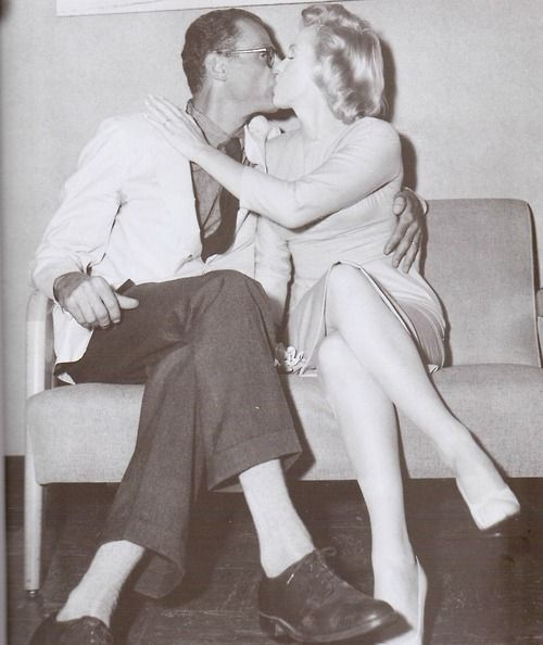 Marilyn And Arthur Kiss For The Reporters At Their Arrival In