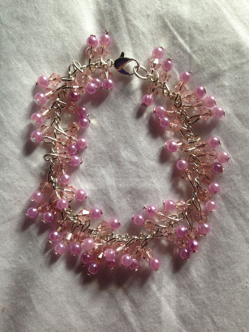 Light pink beaded charm bracelet on silver chain!   Price: £8  Warning: Please keep this bracelet dry at all times! Do not wear it in the shower or continuous water use!