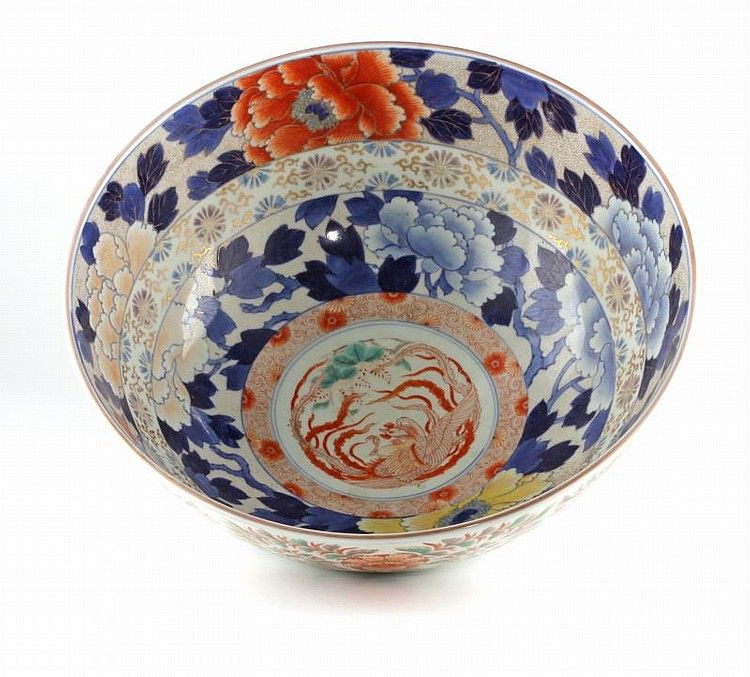 Japanese Imari Punch Bowl early 20th century, the center medallion featuring a phoenix bird and surrounded by concentric bands of floral motifs, the exterior also hand-painted with floral and foliate scrolls, gilt highlights overall, marked on base. 6 x 15 in. diameter