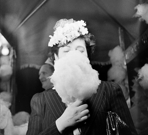 Unknown woman eating cotton candy