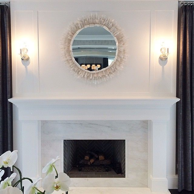 White Marble Fireplace Surround With A Gray Herringbone Firebox