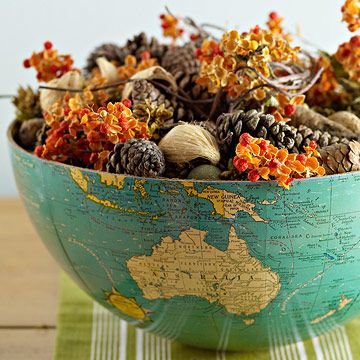 Make a centerpiece for your Global Table by splitting an old globe along the equator and filling it with decor. Add a weighted item at the bottom to keep it steady.