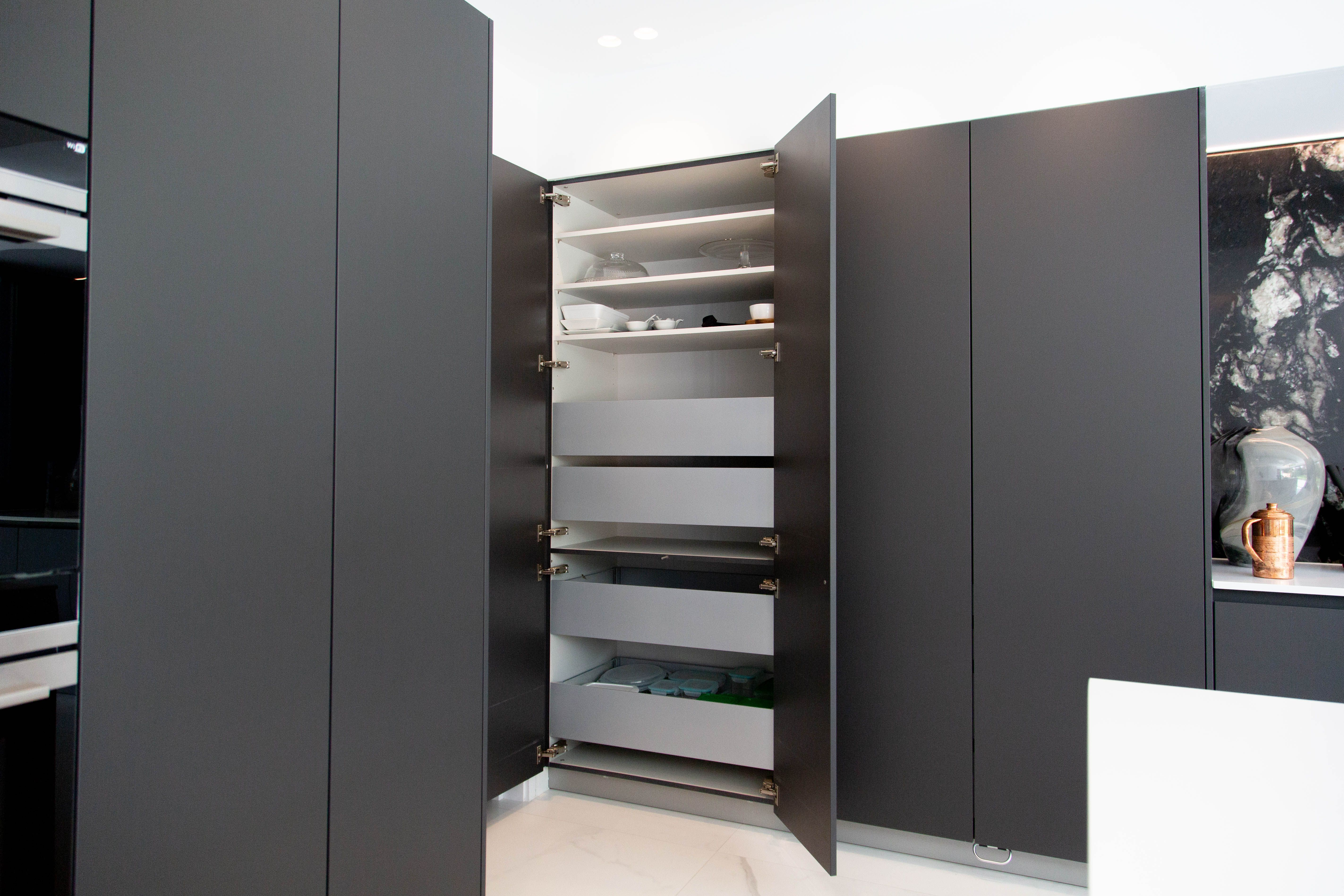 Inside kitchen double pantry units. Based in Wembley, this