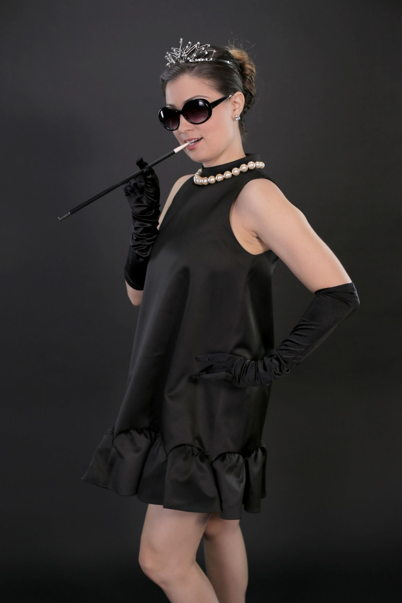 If a black dress is a staple in your wardrobe, then you barely have to lift a finger this Halloween. You can wear a black dress in SO many ways even on a regular day, but this year you can DIY the perfect costume without spending any money — or even leaving your house!