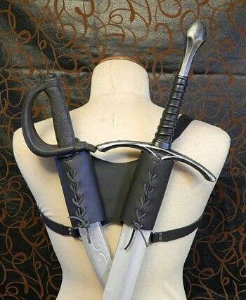 Double Holster, Glenbrook. This design, while fading out to the arquebus, is an easy way to hold two short blades, though is difficult if the wearer is not upright. Front line troopers would likely wear these holsters.