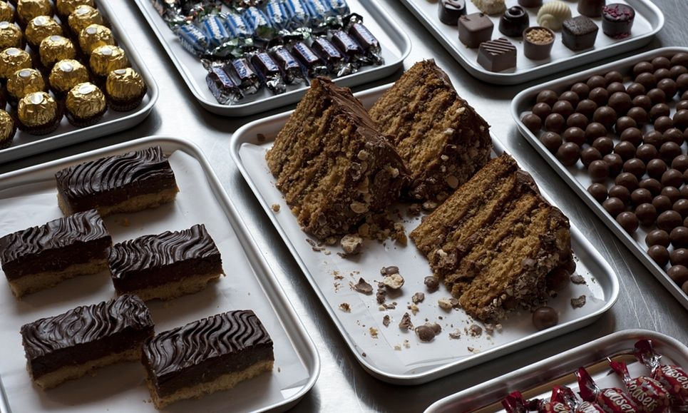 'These chocolate bar inspired concoctions stand out as trashier and less fashionable than ever – exactly as a cake should be' ... Ruby Tandoh's Malteser cake and peanut caramel shortbread.