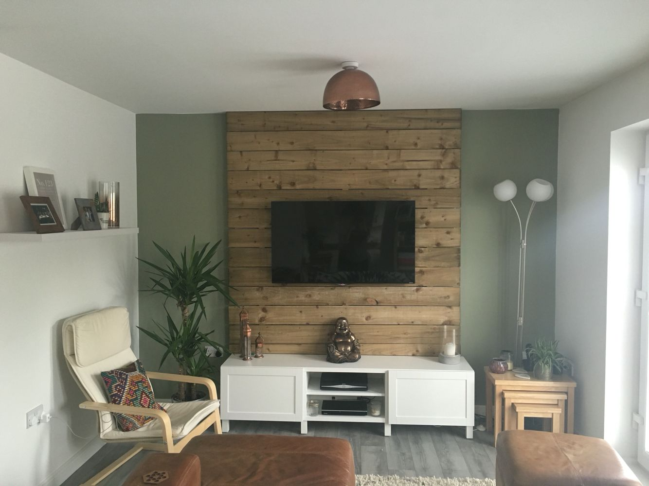 My living room DIY wood pallet wall TV wall mount Earth tones