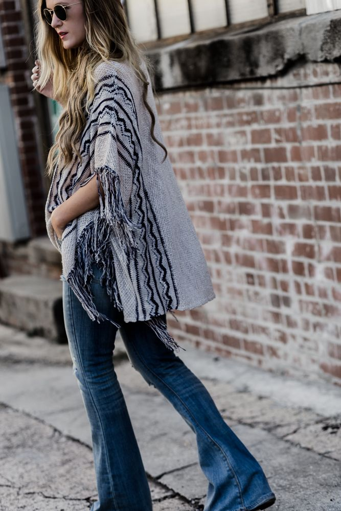 a5ee780edfcc8d Shannon Jenkins of Upbeat Soles shows how to style flared jeans and a fringe  poncho for a spring boho outfit with round Ray Ban Icon sunglasses