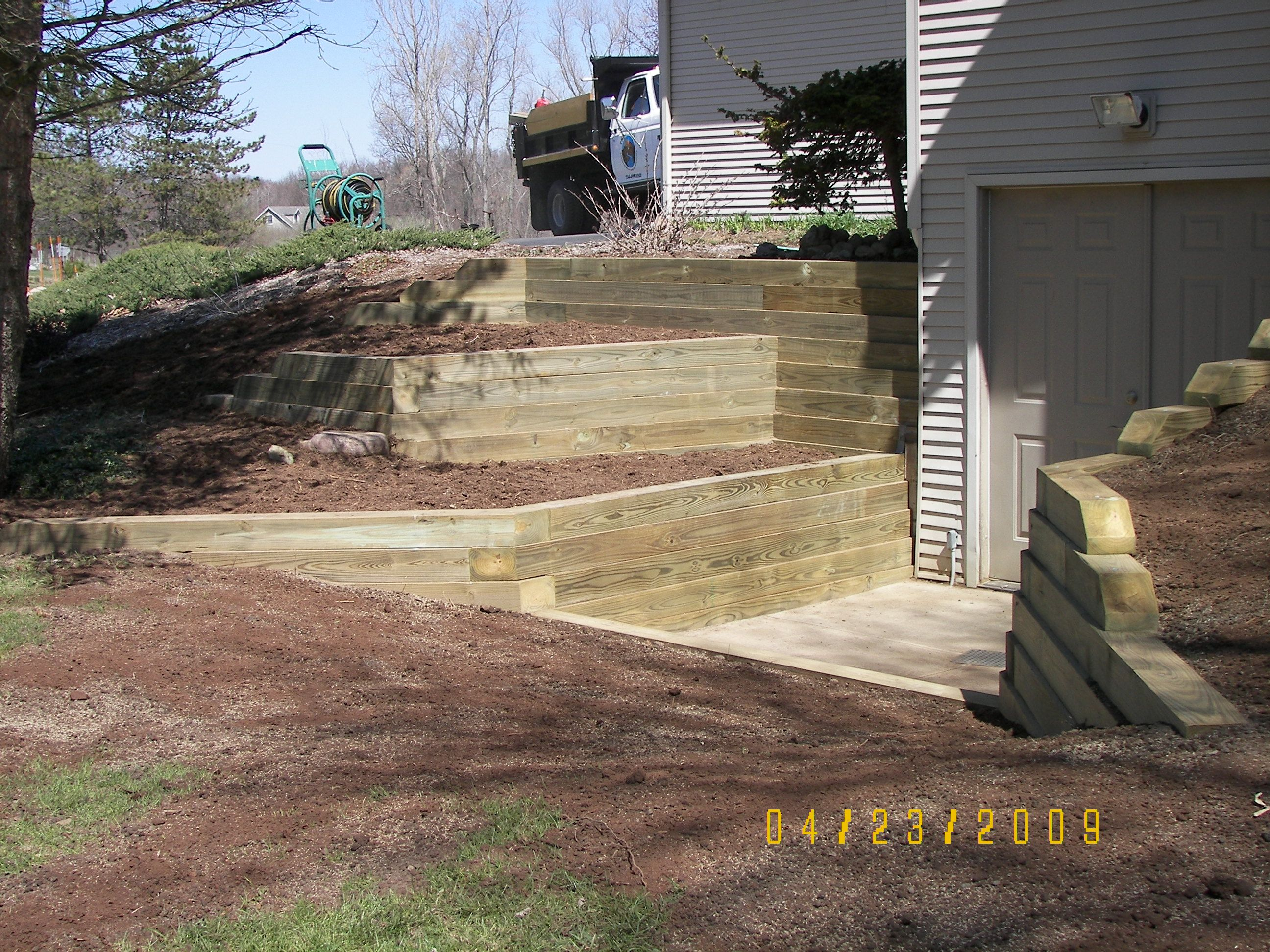 Retaining wall installation contractor egress window for Walkout basement construction
