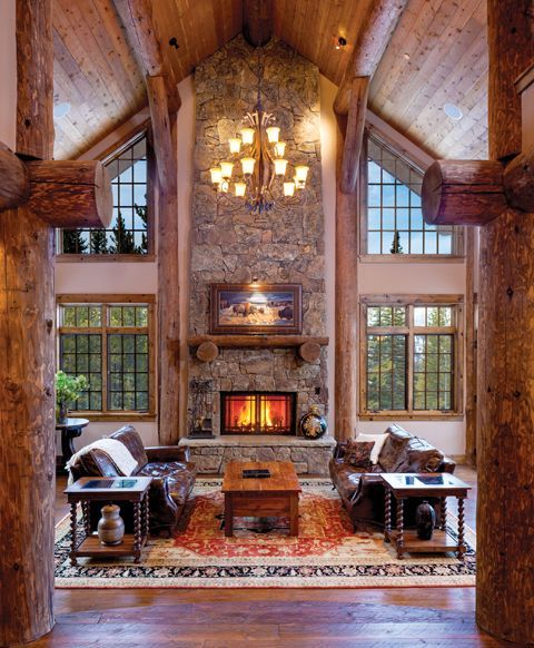 Symmetrical Log Beams And Floor To Ceiling Windows Frame A Two Story Stone Fireplace In One Of Cabin Homes Magazines Favorite Great Rooms