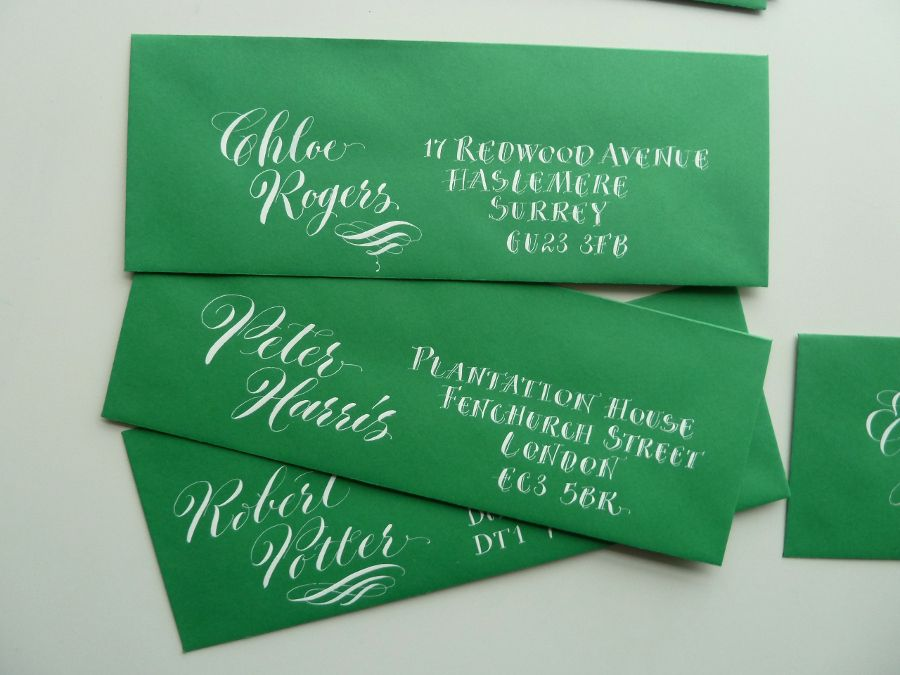 contrasting-mix-of-calligraphy-styles-informal-lettering-on-green-envelopes